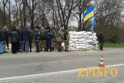 Доброволец пытался перевезти через блокпост в Запорожской области арсенал оружия